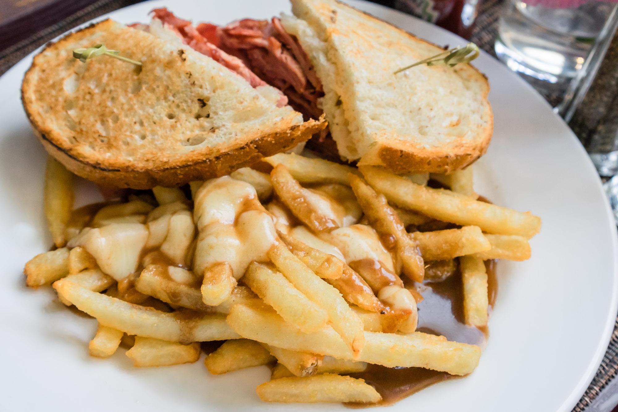 Monday dinner in Winnipeg. Reuben sandwich with poutine.