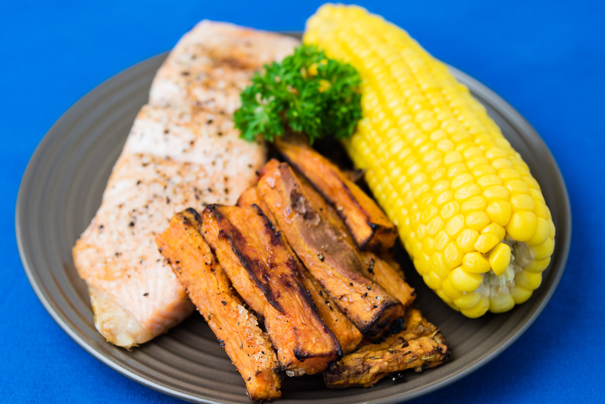Saturday dinner. Baked salmon with sweet corn and sweet potato chips.
