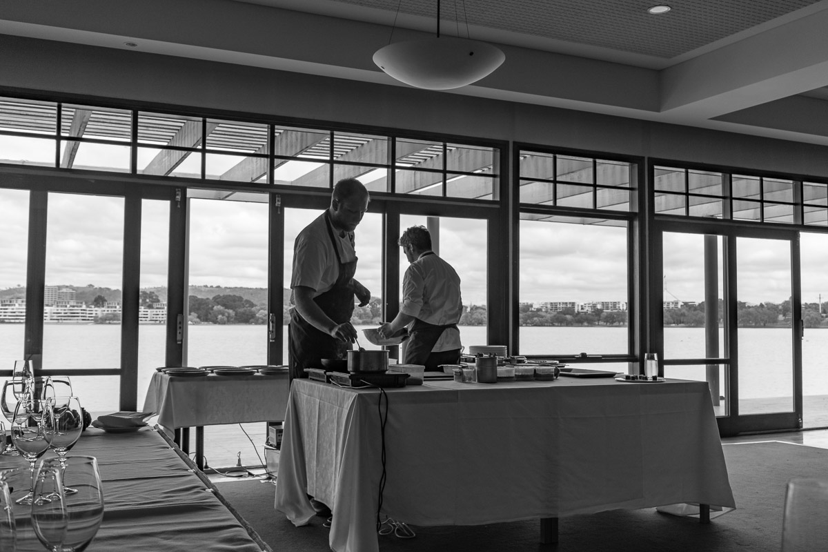 This is a black and white photograph of The Boathouse by the Lake chefs JOHN LEVERINK and ALEX O'BRIEN