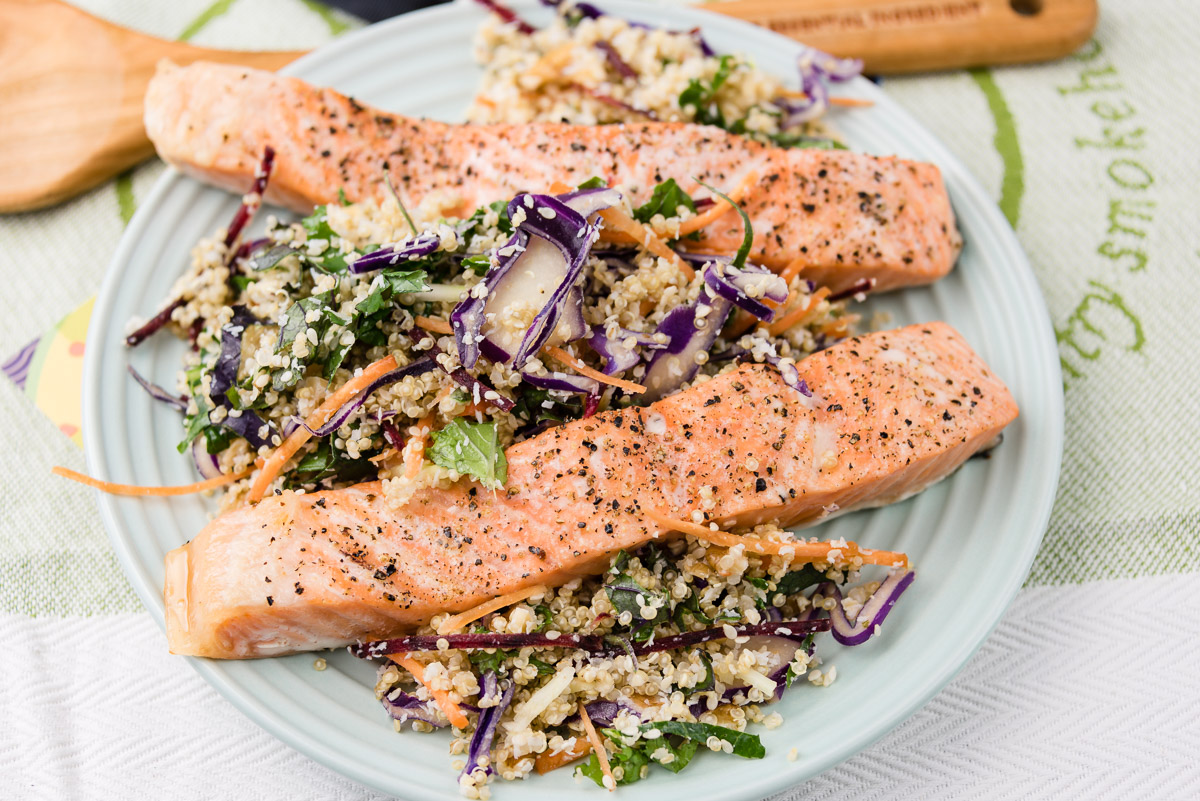 This is a photograph of Monday dinner. Watch me eat baked salmon with quinoa kale coleslaw with walnuts, coconut and sesame seeds.