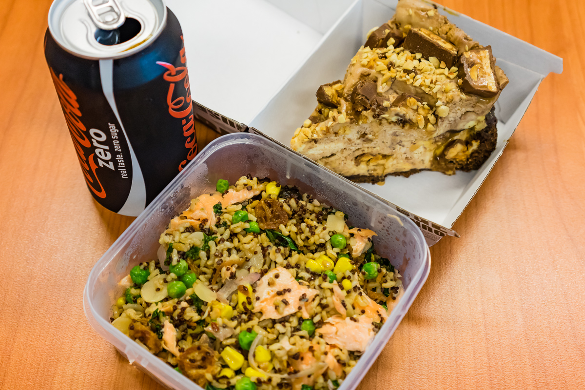 Photograph of my leftover Fried brown rice with red quinoa and kale and flaked baked salmon. Plus snickers cheesecake.
