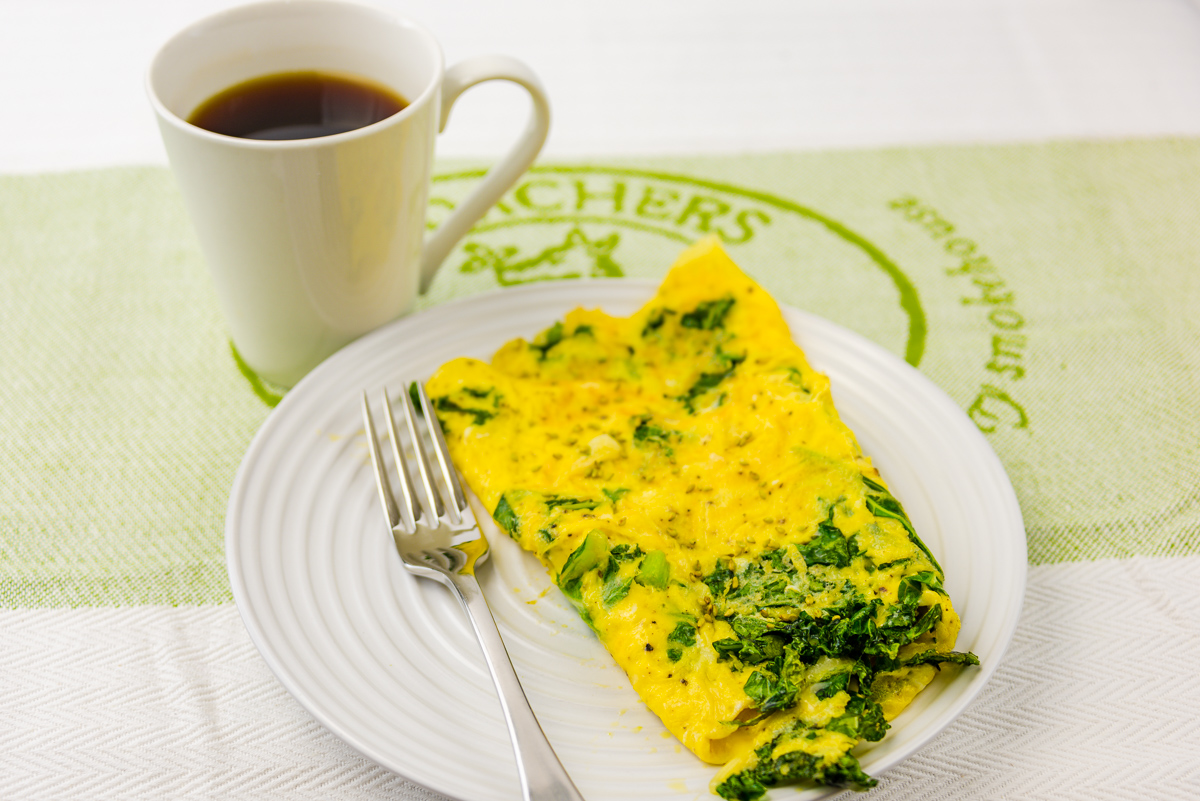 Cheese and kale omelet with coffee.