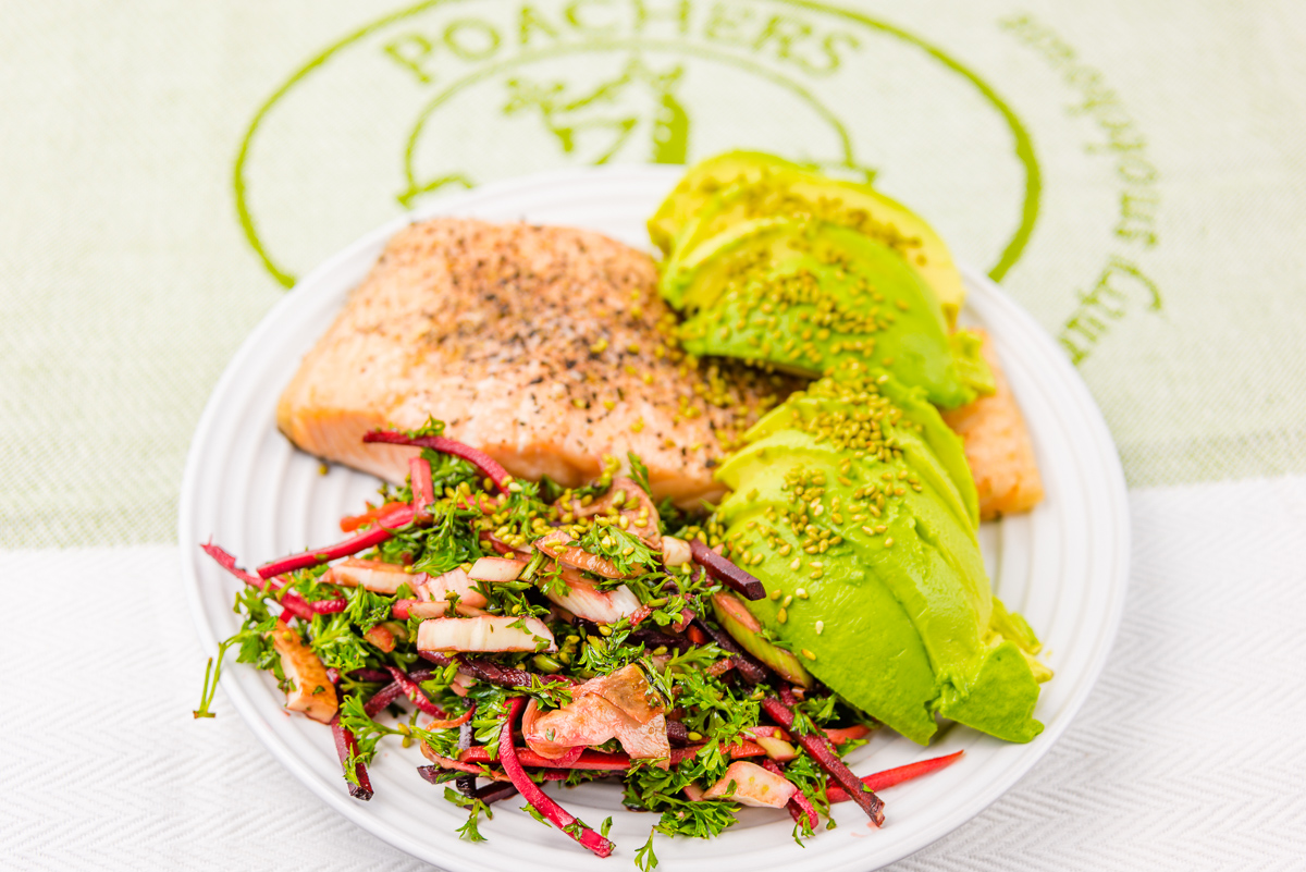This is a photograph of Baked salmon with pickled coleslaw and avocado