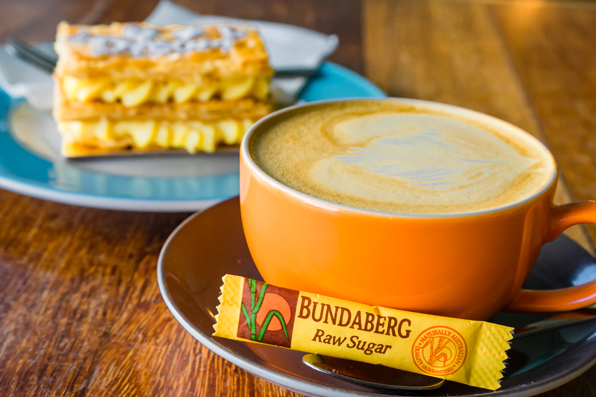 This is a photograph of Dream Cuisine Vanilla Slice, coffee and Bundaberg raw sugar