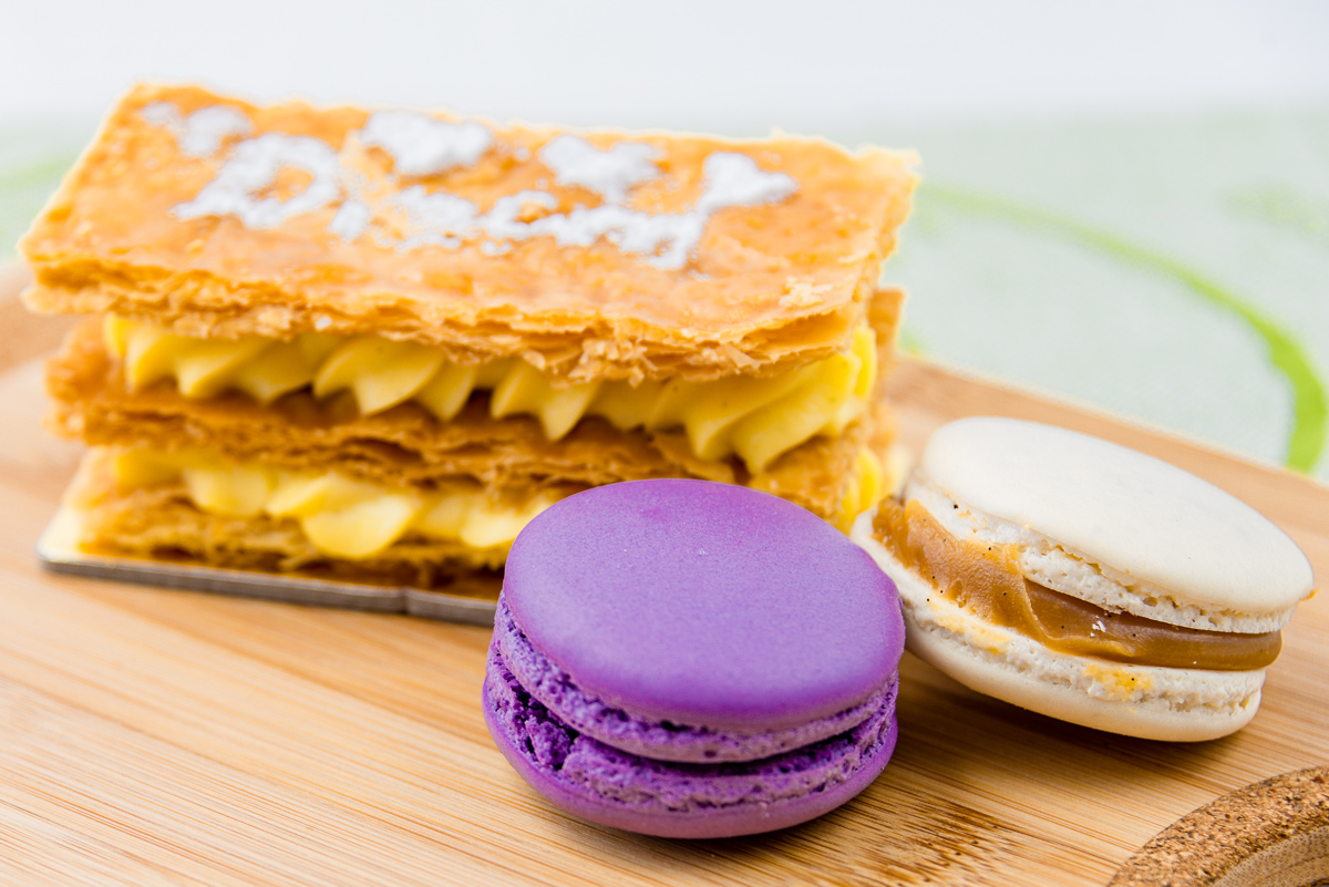 This is a photograph of Dream Cuisine Vanilla Slice, lavendar macaron and salted caramel macaron