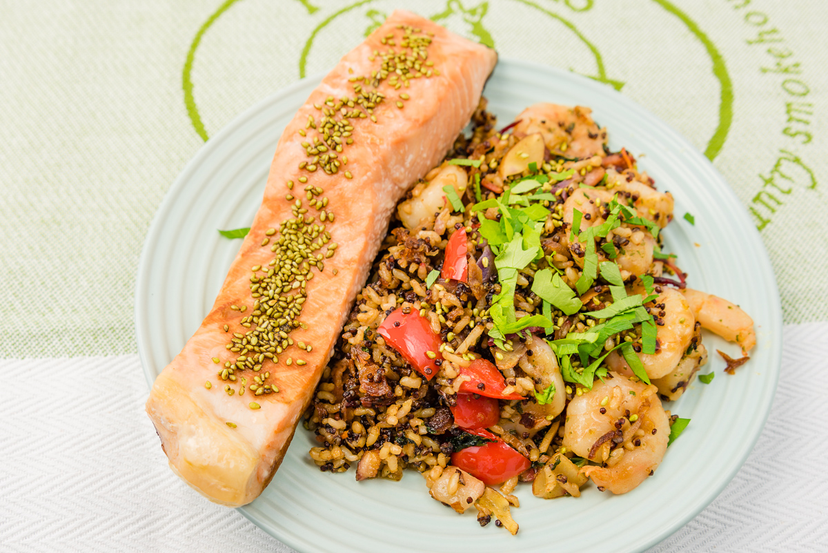 This is a photograph of my Baked salmon with leftover fried quinoa rice with kale and garlic prawns