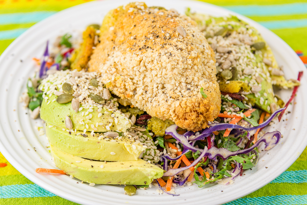 Chicken Kiev with avocado and kale coleslaw