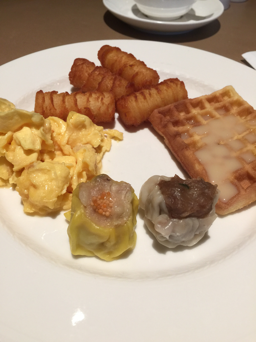 Breakfast deep fried potatoes, scrambled eggs, dim sum and waffles with condensed milk