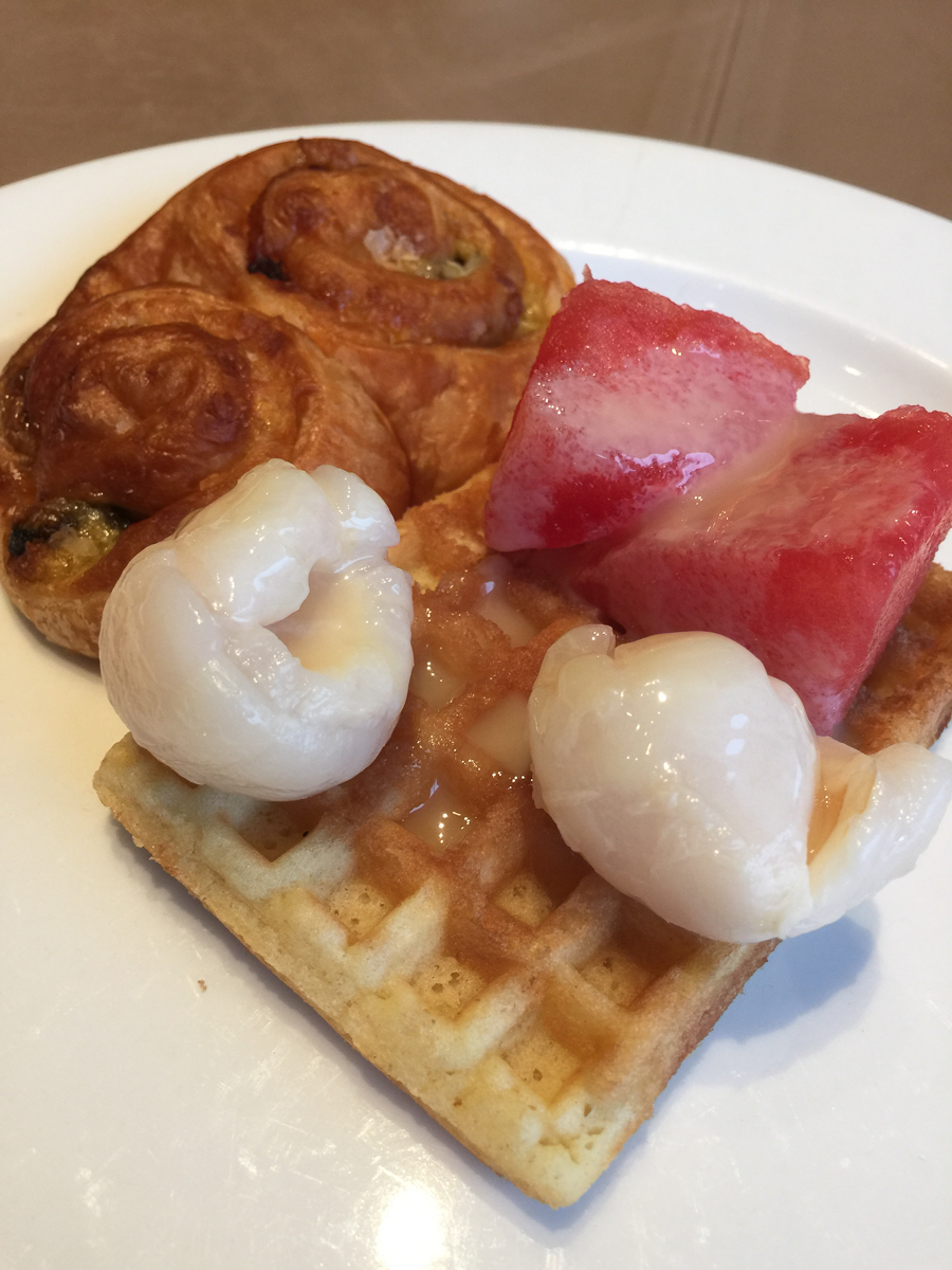 Danish with watermelon and lychee on a waffle and condensed milk