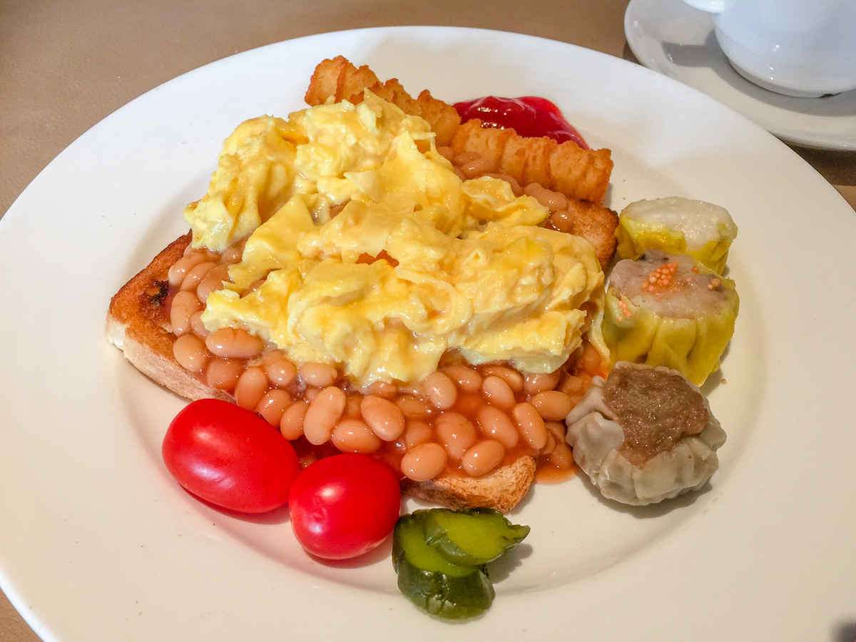 Scrambled eggs and baked beans combined with dim sum and pickles