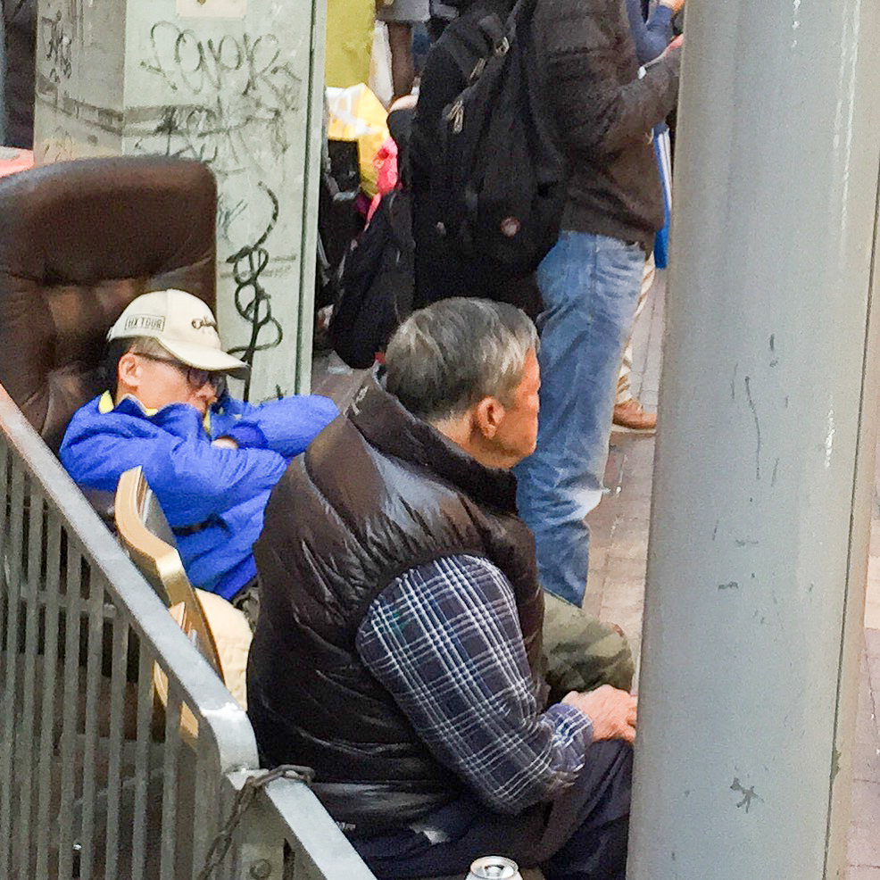 "Men in ""Dad seats"" outside Sasa in Mong Kok"