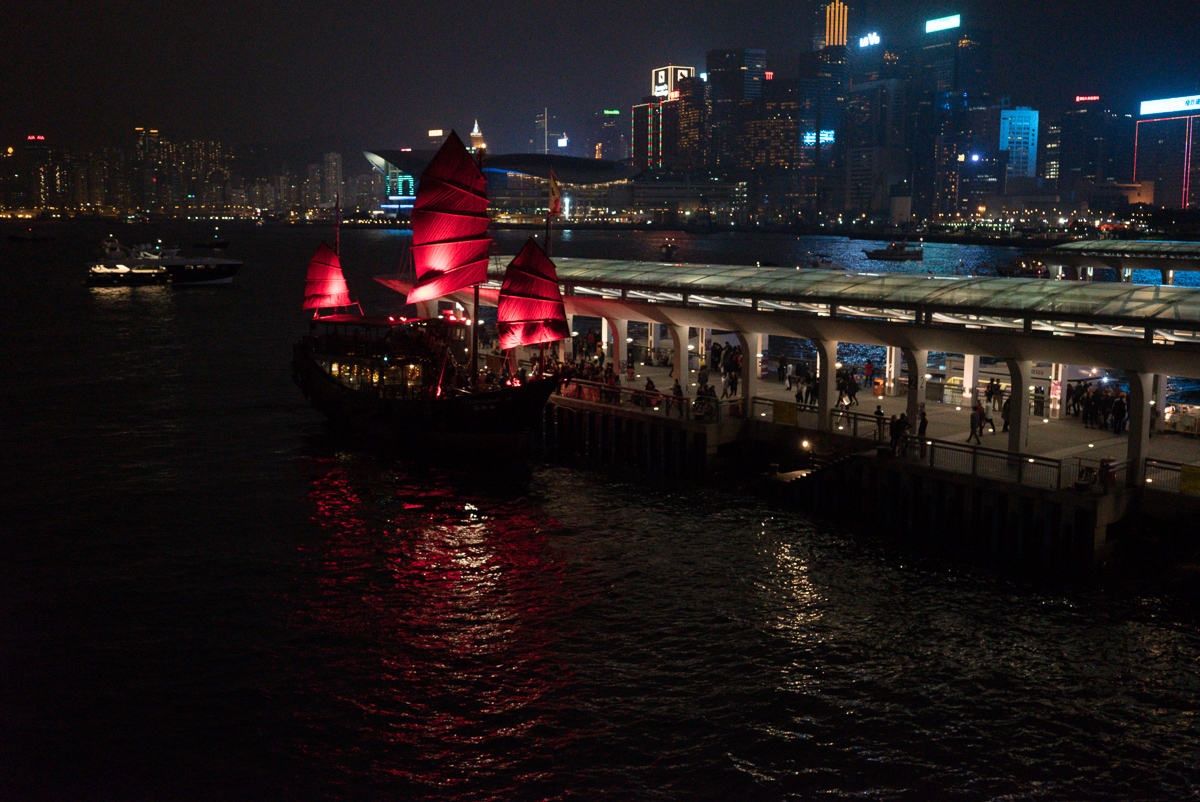 Red sailed boat in the harbour on new year's eve Hong Kong