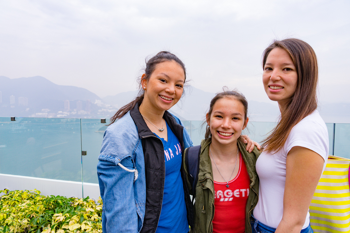 A photograph of Miss14, Ms18 and Ms20 with Deep Water Bay in the background