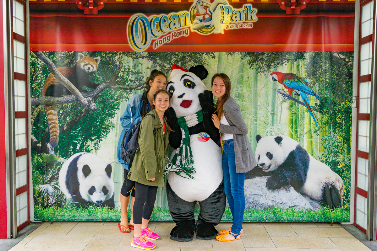 A photograph of Miss14, Ms18 and Ms20 with a Giant Panda