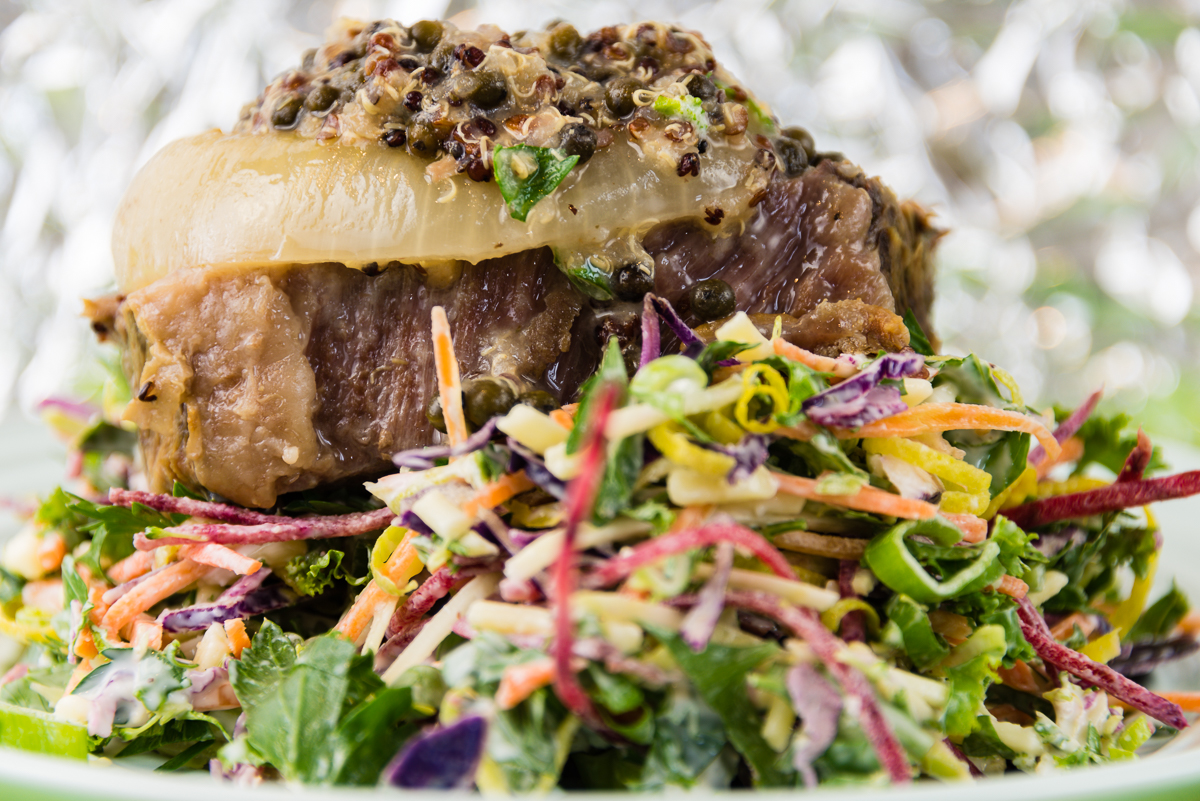 Photograph of Vacuum packed roast beef, quinoa and onion with kale coleslaw and green peppercorns