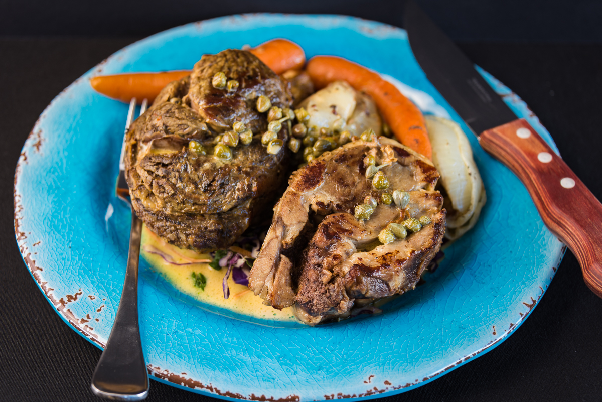 A photograph of my Leftover vacuum packed rib eye beef and lamb shoulder with creamy caper sauce served with carrot and onion.