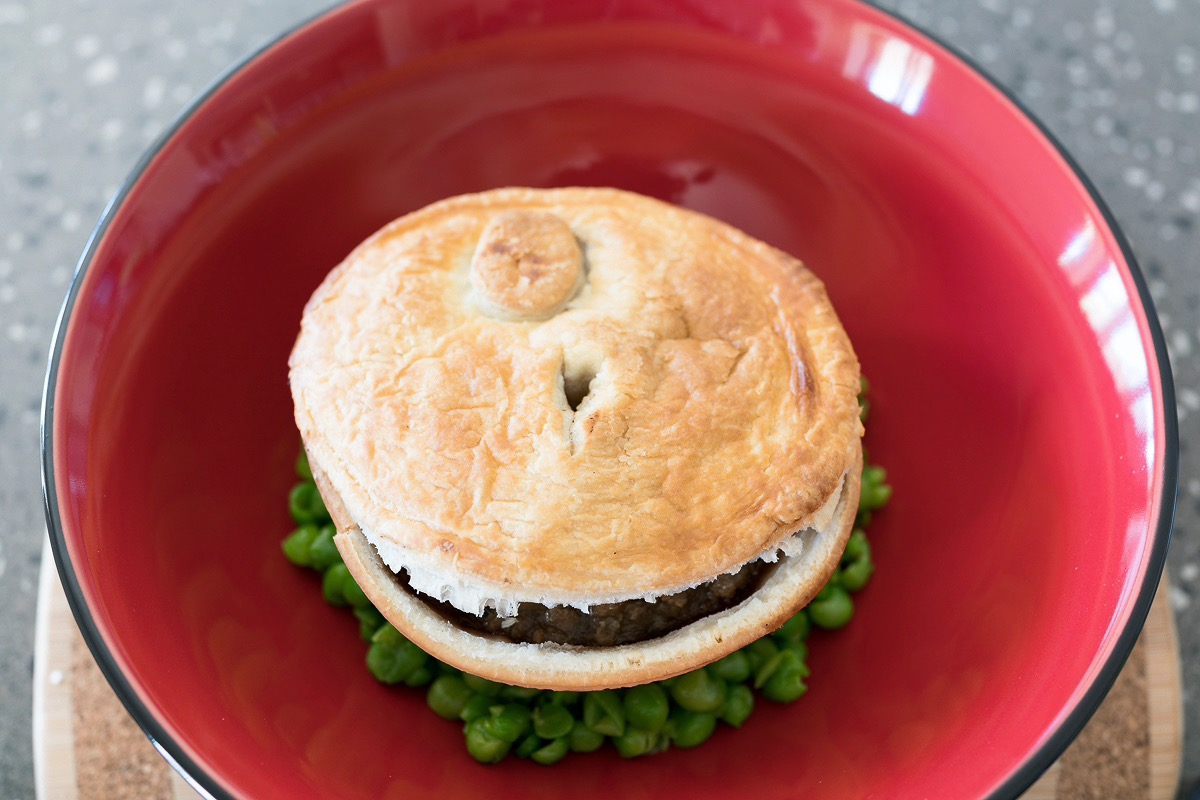 pie floater Beef and mushroom meat pie on mushy peas