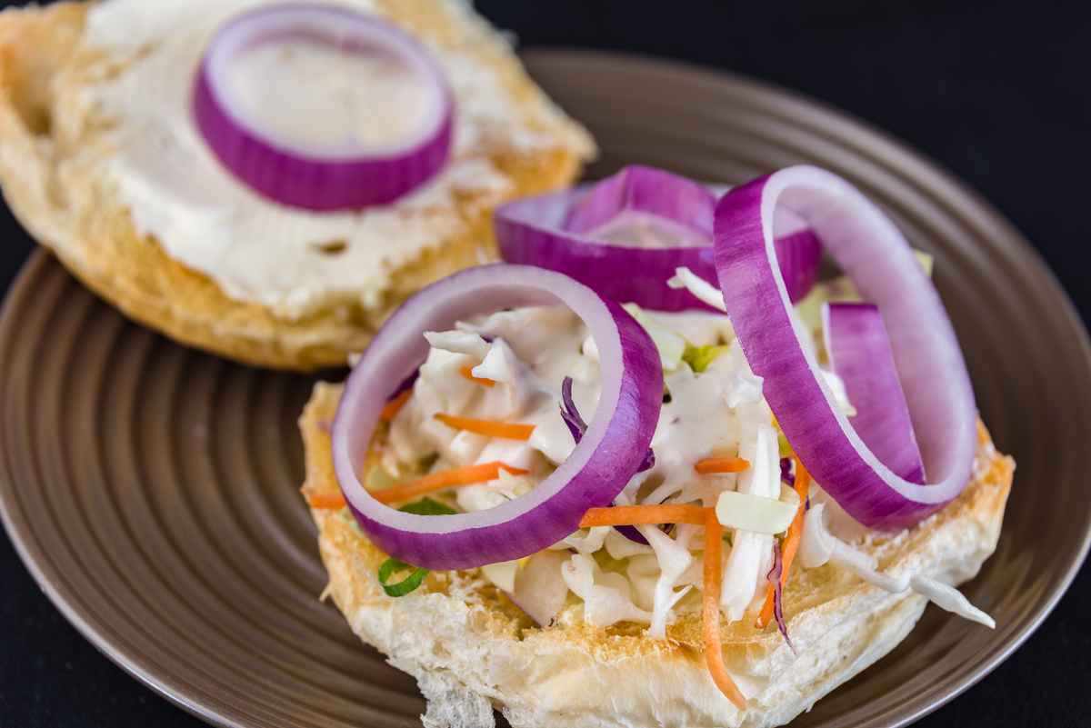 Gary Lum Red onion with coleslaw in a cream cheese sandwich