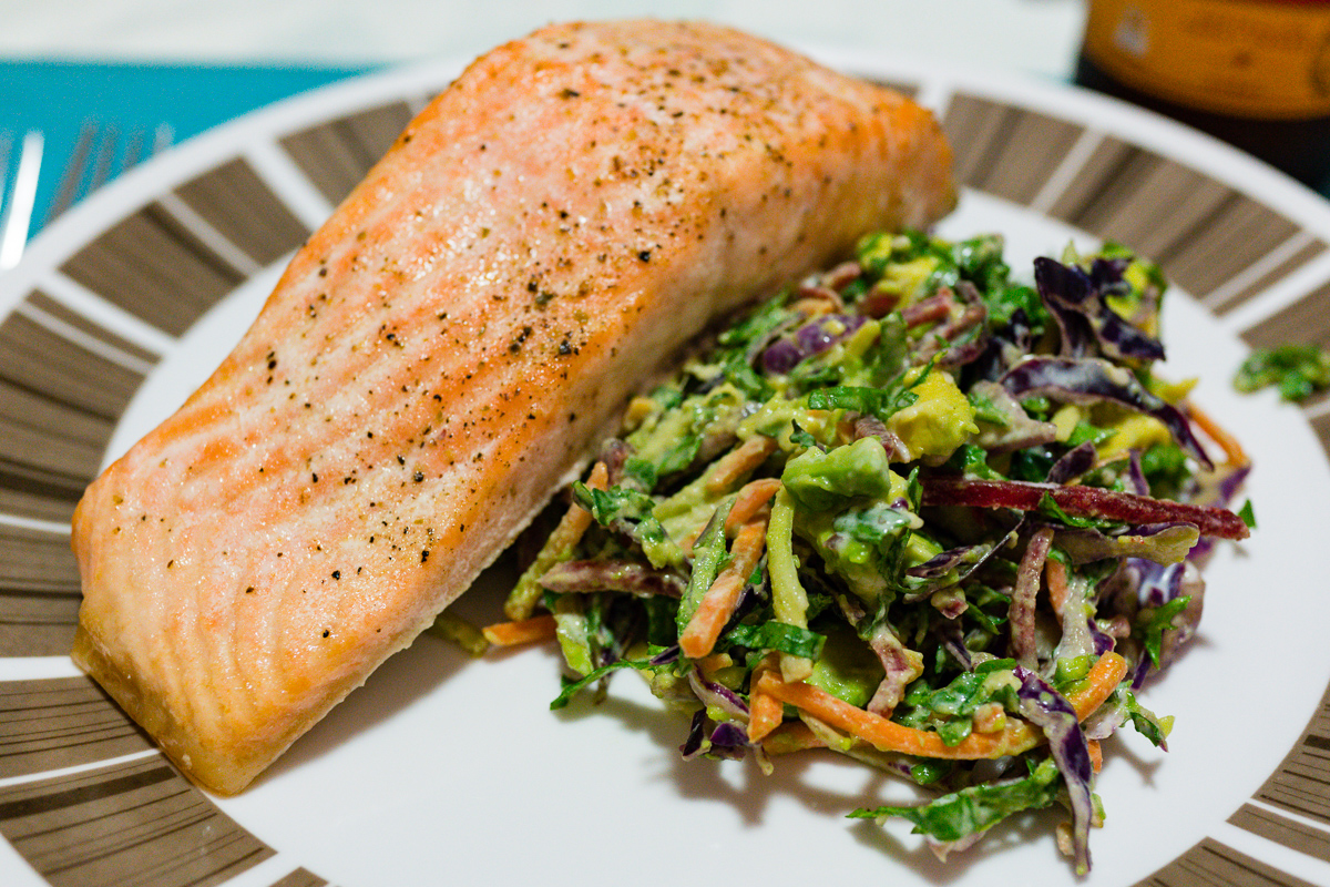 Baked salmon with kale and avocado coleslaw