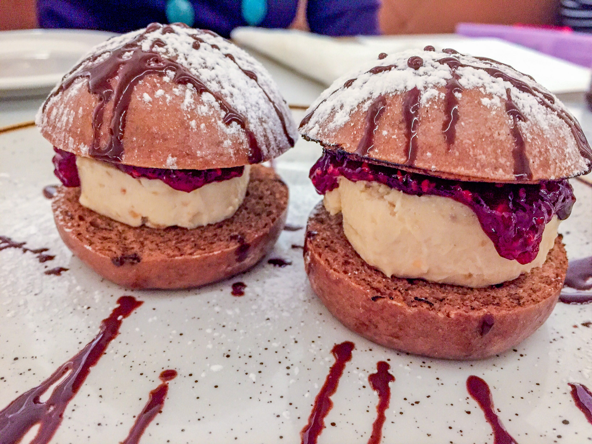 XO Restaurant's hot cross bao! Fresh bao made in house with Sichuan chilli raspberry jam and salted praline peanut paste ice cream drizzled with dark chocolate. They're vegan and dairy free!