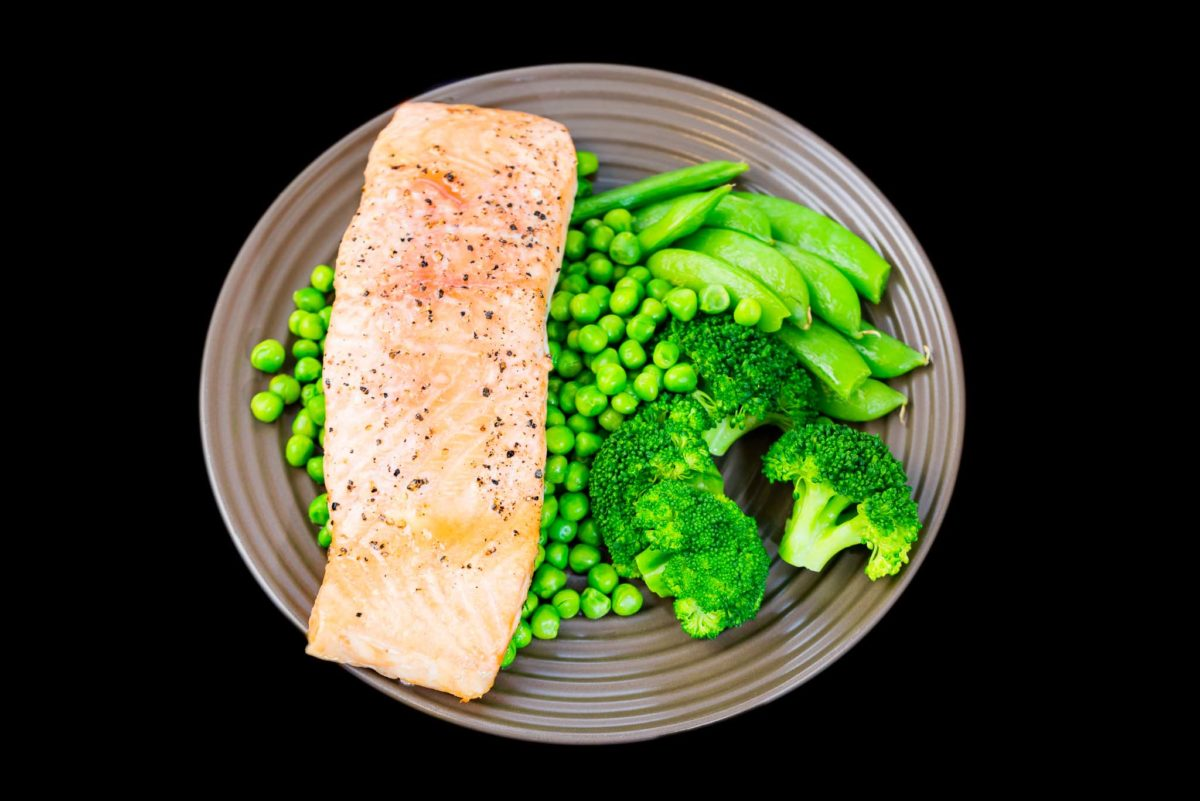 Baked salmon with peas, sugar snap peas and broccoli
