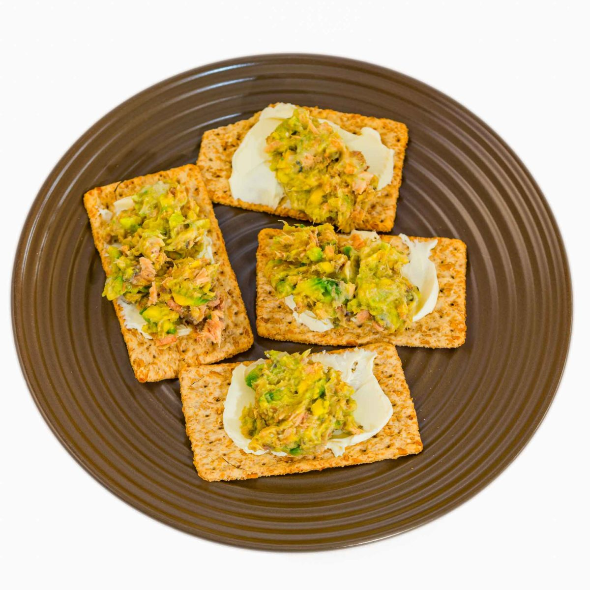 Tinned pink salmon with avocado on Vita-Weat with cream cheese