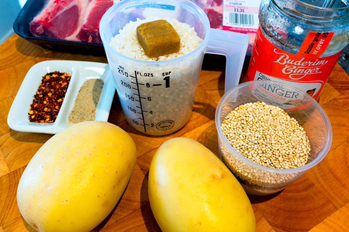 Ingredients for pork congee including quinoa, rice, potatoes, coconut, chilii flakes, pepper, ginger marmalade, speck and pork spare ribs