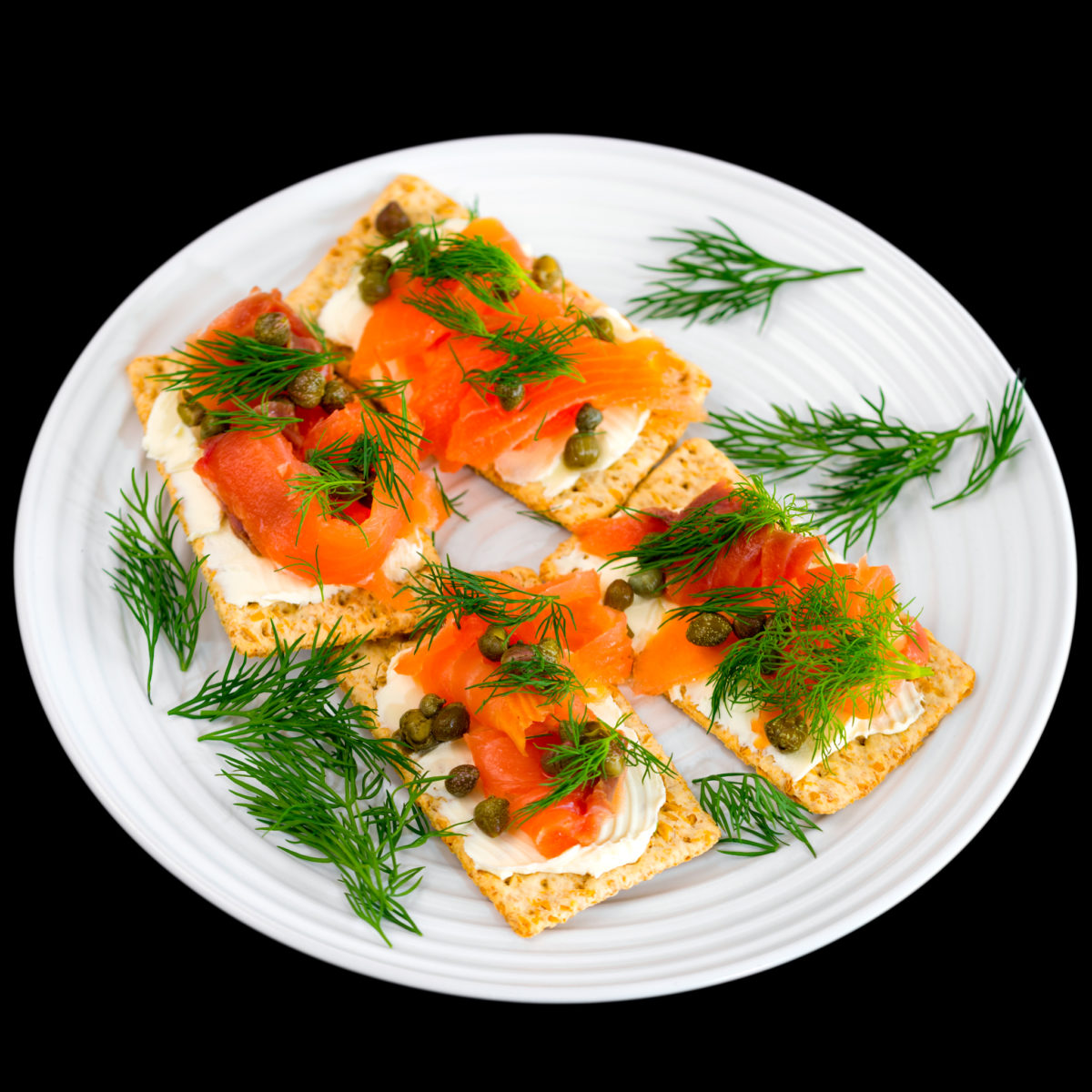 Smoked salmon with cream cheese, capers and dill on Vita-Weat biscuits for lunch