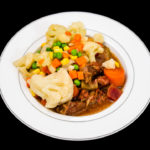 Slow cooker beef and potatoes with corn, carrots, cauliflower, peas, beetroot, celery, and mushrooms