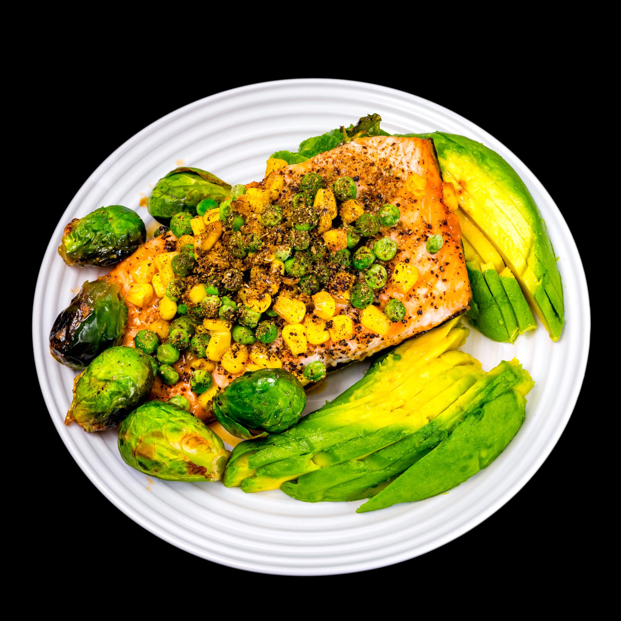Honey soy baked salmon with vegetables including Brussels sprouts and avocado