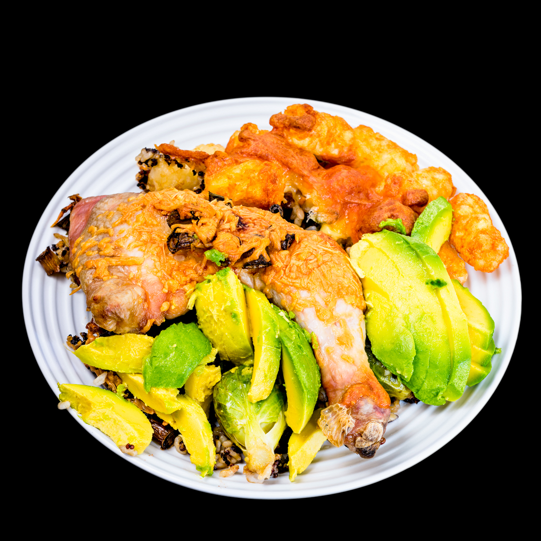 Chicken Maryland with crunchy quinoa rice, avocado, Brussels sprouts and cheesy potato gems