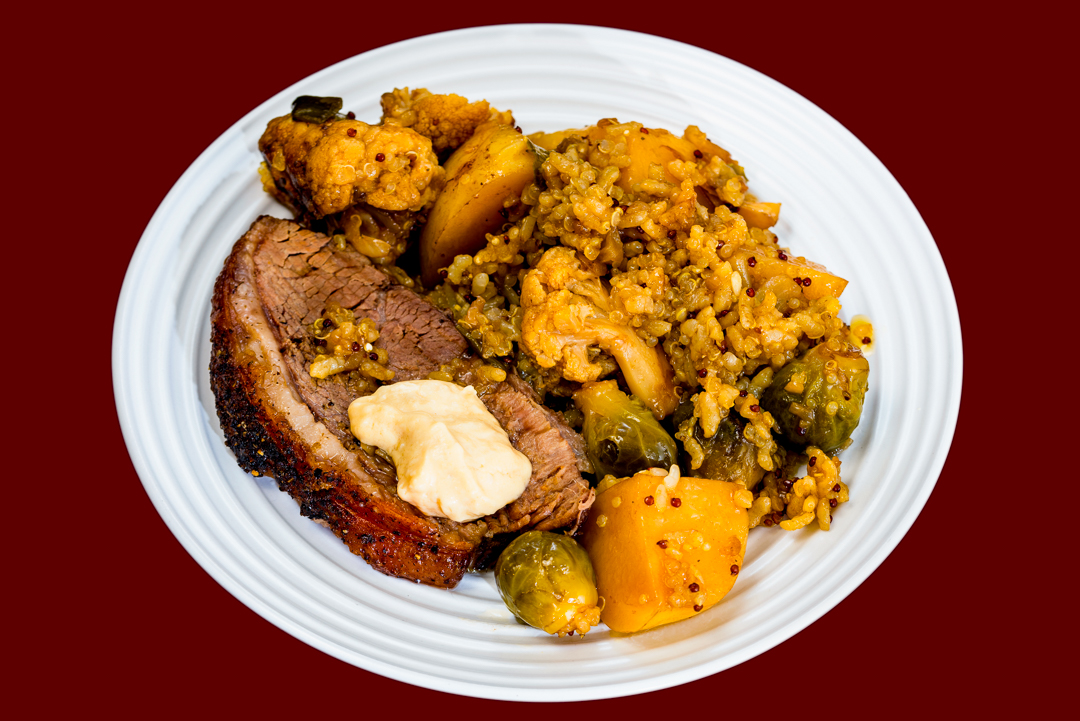 Slowly oven roasted rump of beef with potato, cauliflower, onion, Brussels sprouts, quinoa and rice served with horseradish