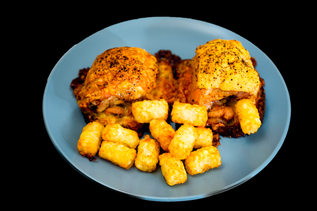 Roast cheesy chicken thighs on crunchy cheesy bread with potato gems