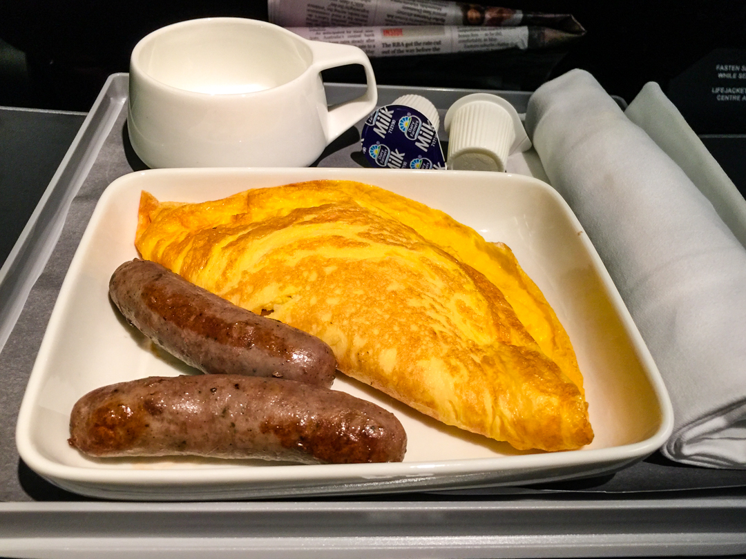 QF795 CBR to MEL Cheese omelet with sausages
