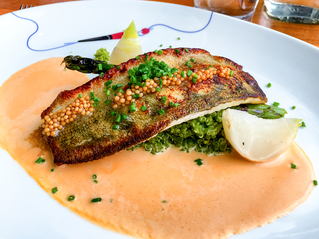 Roasted pike-perch with spinach quinoa, grilled asparagus and lobster sauce at Meripaviljonki Ravintola Restaurant
