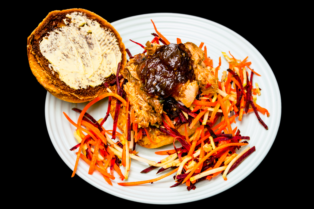 Pulled pork sandwich with coleslaw and caramelised onion