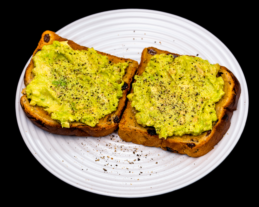 Sunday breakfast. Smashed avocado on raisin toast