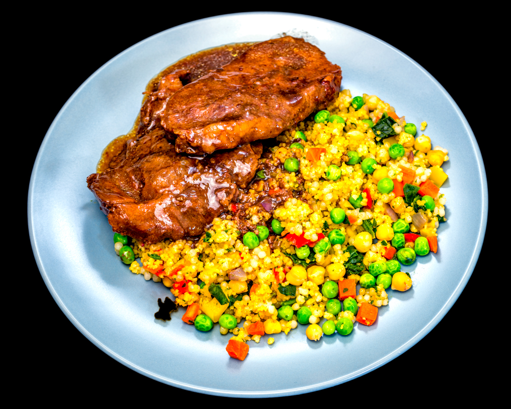 Sunday dinner. Slowly cooked boubon barbecue oyster blade steak with pearl couscous, chickpeas and vegetables