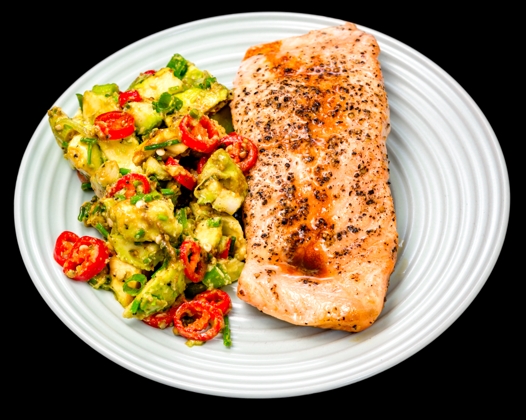 Pan fried salmon fillet with diced avocado, chilli, spring onions and chives in a maple syrup dressing