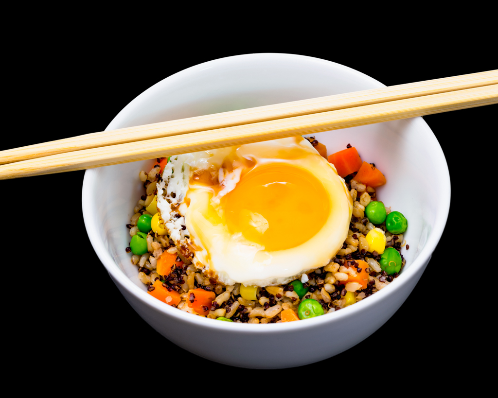 Fried egg with quinoa rice and vegetables