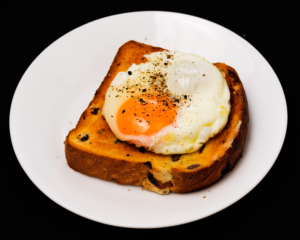 Fried egg on Brioche raisin toast