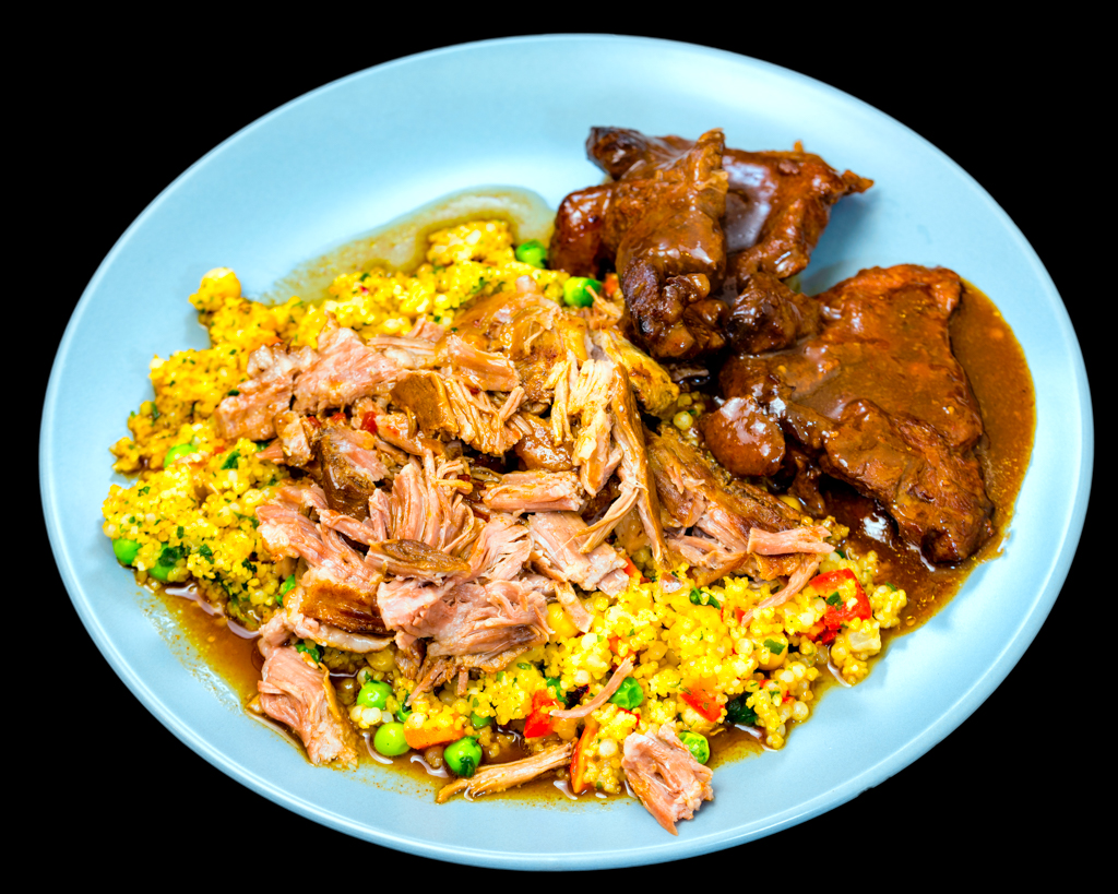 Slowly cooked pulled pork with beef and pearl couscous plus chickpeas and vegetables