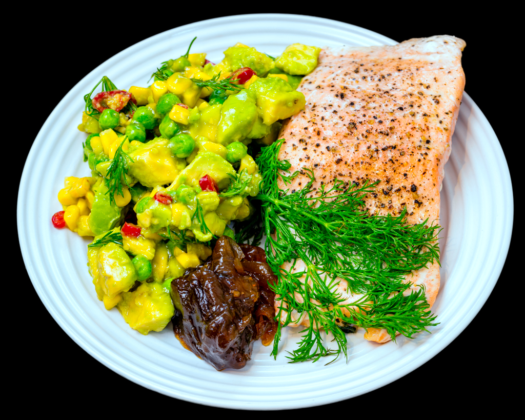 Pan fried salmon with dill, chilli, avocado, peas and corn along with caramelised onion