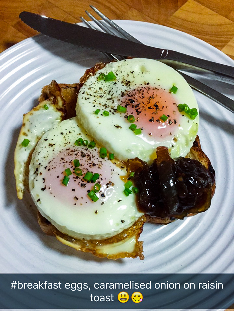 Fried eggs with caramelised onion on raisin toast