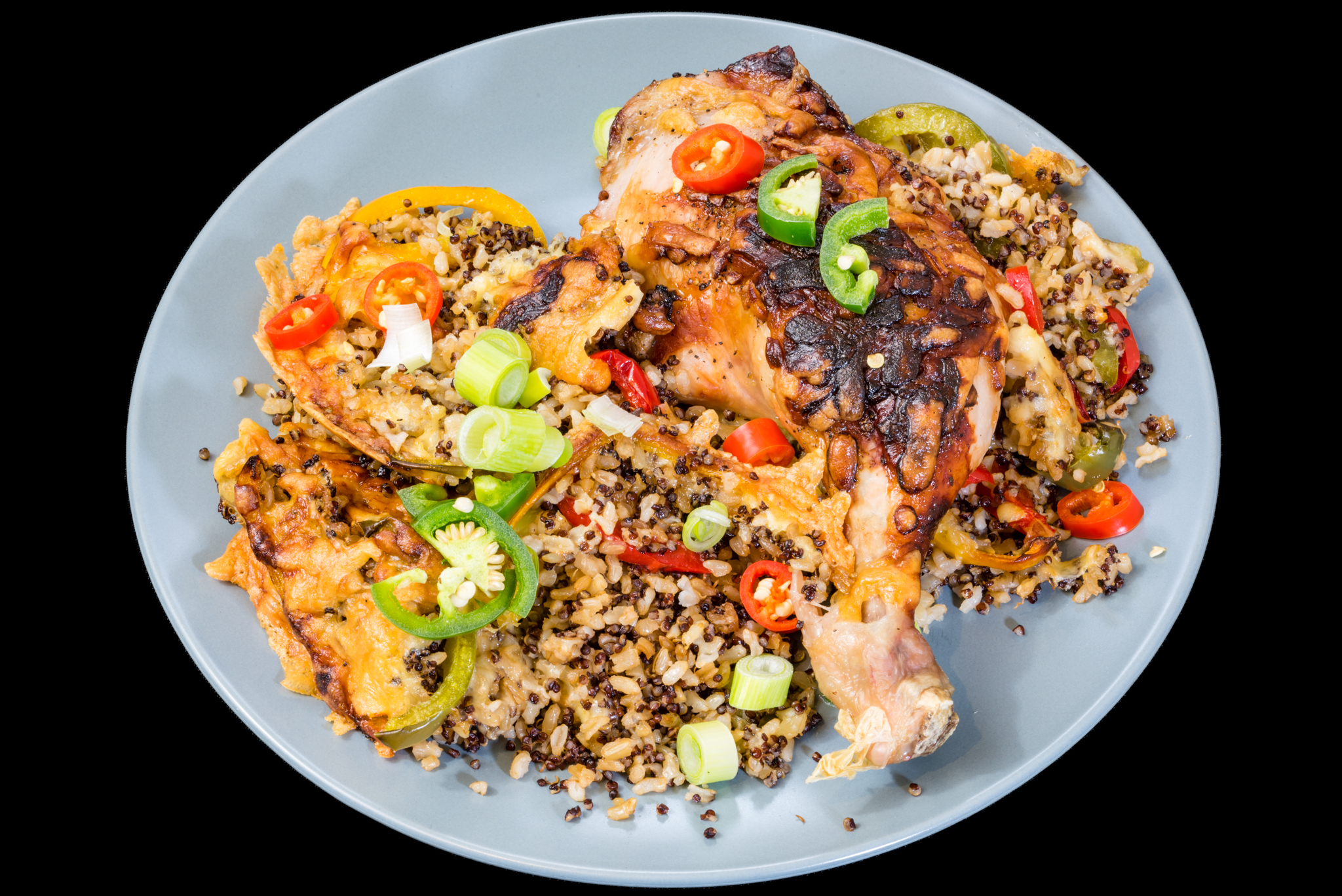 Baked cheesy Chicken Maryland with crispy quinoa rice, capsicum, jalapeños, chillis and spring onions