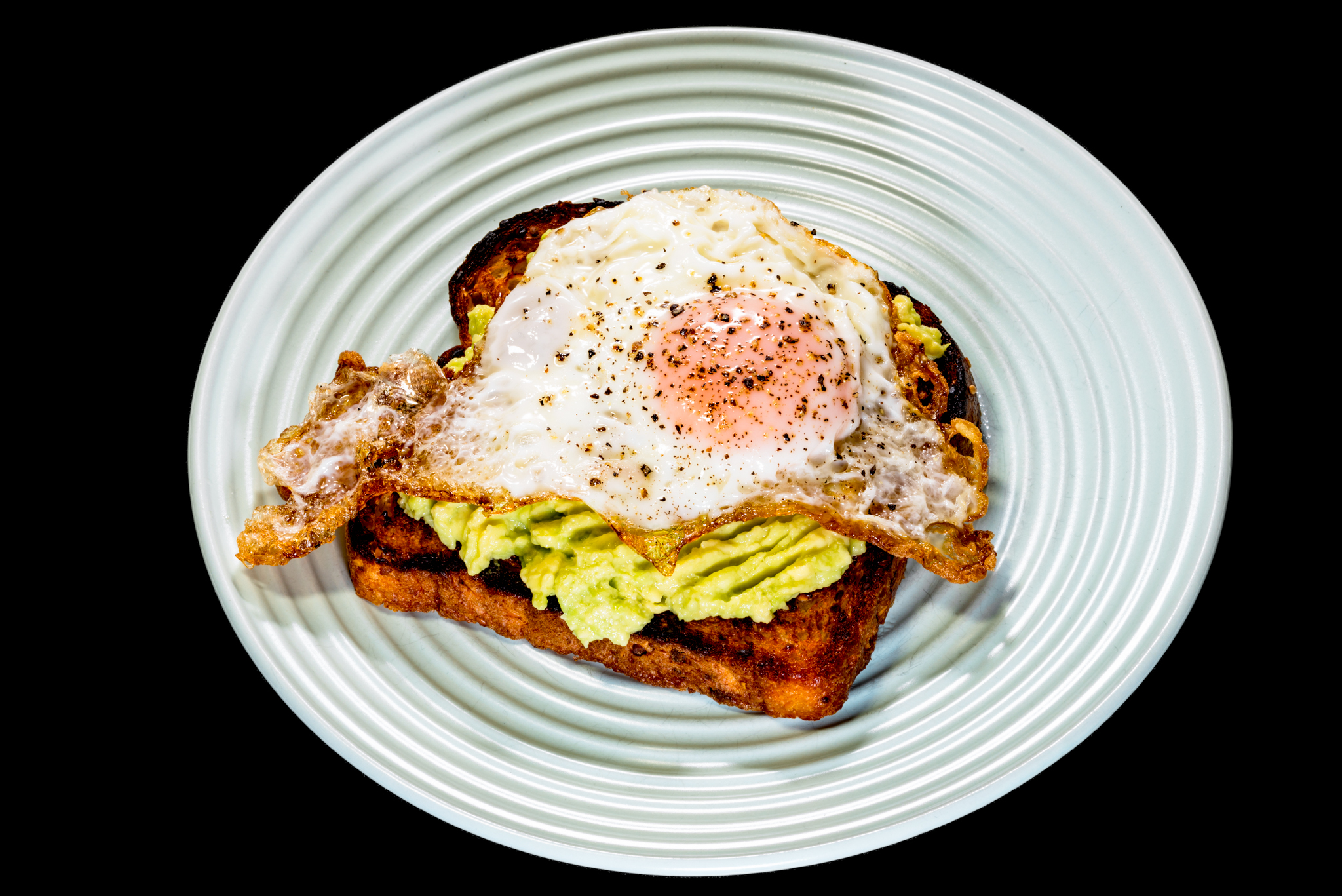 Avocado on fried bread with a fried egg Gary Lum