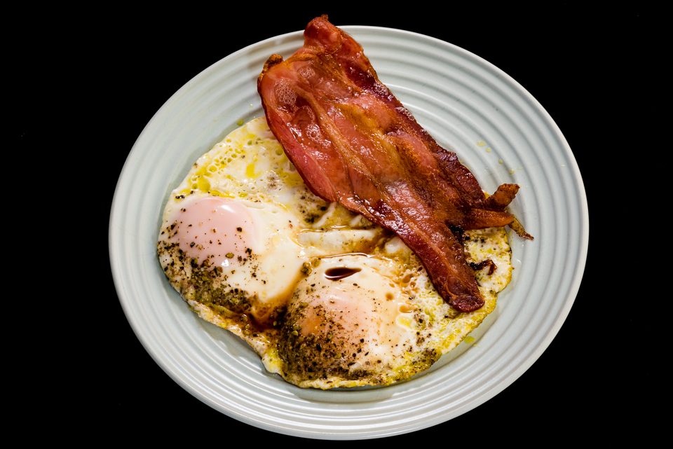 Crispy streaky bacon and fried wasabi sesame seeded eggs with Worcestershire sauce #breakfast #yummylummy #foodporn #yummy #delicious #instafood #nikon Gary Lum