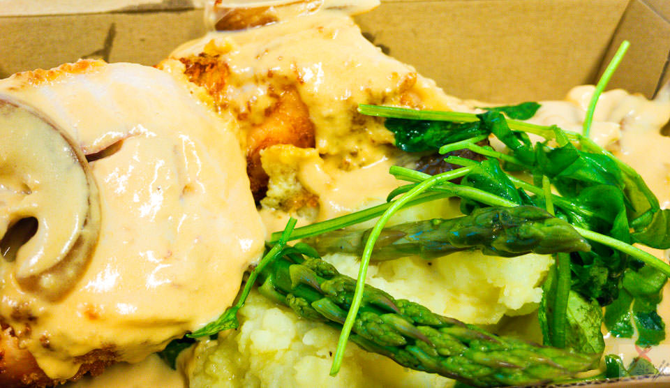 Chicken cordon bleu. Chicken breast wrapped with ham and Swiss cheese with garlic butter and served with mashed potato carrot and asparagus. Gary Lum