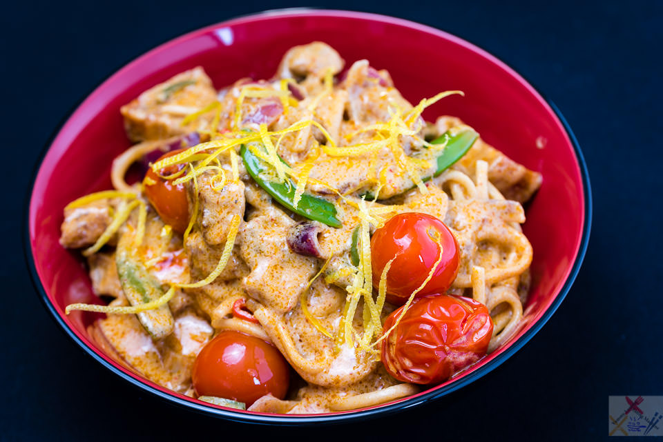 Roast belly pork red curry with noodles, tomatoes, sugar snap peas and lemon zest Gary Lum
