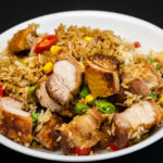 Roast pork rashers with crispy crackling and rice Gary Lum